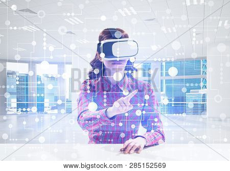 Beautiful And Young Woman In Red Checkered Shirt Using Vr Goggles And Interracting With Digital Medi