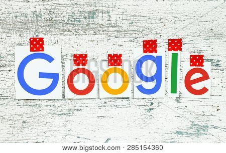 Kiev, Ukraine - January 25, 2019: Google Logotype Printed On Paper, Cut And Taped With Red Adhesive