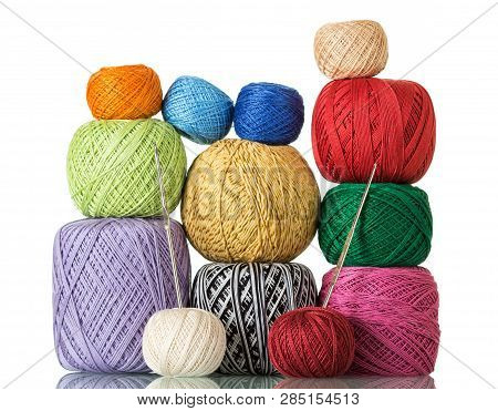 Various Colorful Skeins Of Wool Yarn And Crochet Hooks Isolated On White Background