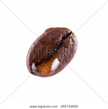Flavorful Medium Roast Coffee Bean With A Drop Of Drink Isolated On White Background