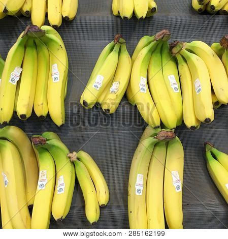 Bracknell, England - February 20, 2019: Ripe Yellow Bananas Displayed In Bunches On A Market Stall I