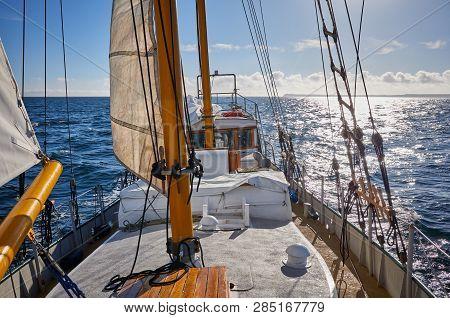 Old Schooner Sailing Against The Sun, Travel Concept.