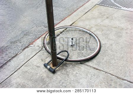 Bike Wheel With Padlock. Theft Of A Bicycle. Bicycle Stolen And Left Only Wheel.