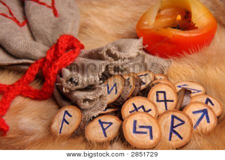 Runes With Pouch And Candle Close-Up