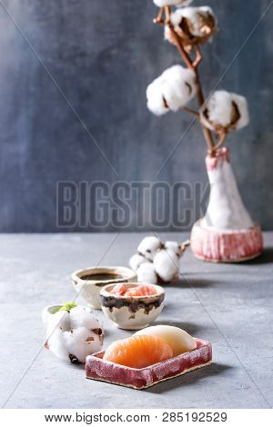 Sushi Set Nigiri With Salmon And Butterfish In Pink Ceramic Serving Plate With Bowls Of Soy Sauce An