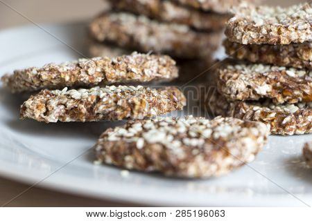 Vegan Cookies From Wheat And Raisins On White Plate