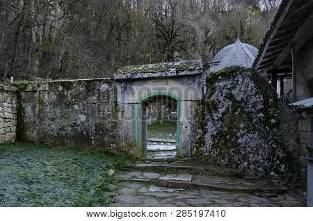 Panorama an inner courtyard with entrance toward tomb in Demir Baba Teke, cult monument honored by both Christians and Muslims in winter near Sveshtari village, Municipality Isperih, Razgrad District, Northeastern Bulgaria poster
