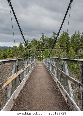 Empty Suspension Bridge Crossing Canyon In Yellowstone Wilderness