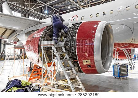 Aviation Industry, Mechanic Repairs Aircraft Engine Jet
