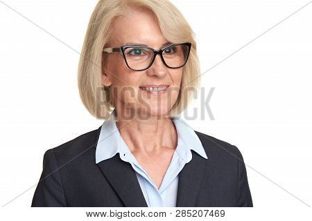 Mature Woman In Suit Wearing Glasses