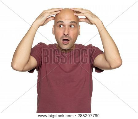 Surprised Bald Man Holds His Head In Hands