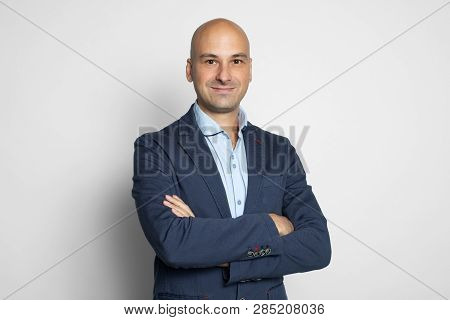 Cheerful Handsome Bald Man Smiling. Isolated
