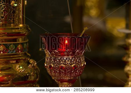 Burning Fire Flame In Oil Icon Lamp. Orthodox Church. Old Style Gilding Holder. Icon Lamp Made From