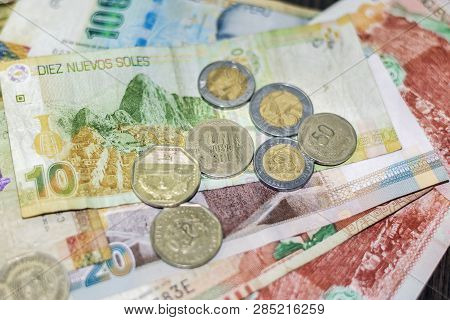 Different Peruvian Currency With Focus On Central Coins