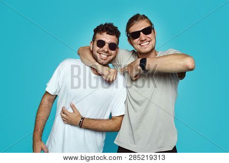 Two Young Hipster Men Have Good Relationship And Truthful Friendship, Embarce Each Other And Smile G