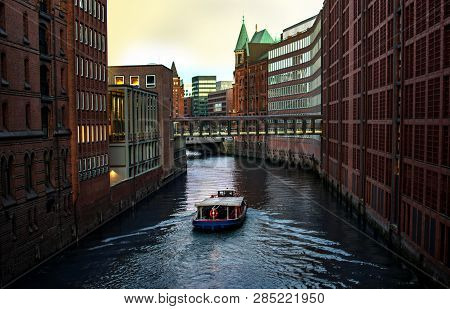 River, Boat And Modern Building With River. Modern Venice. The Canals Of Hamburg On The Elbe River.