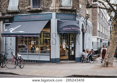 London, Uk - February 16, 2019: People Sitting At Outdoor Tables Of Anthony Delicatessen Cafe In Pri