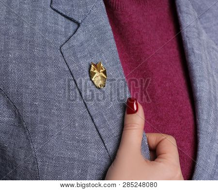 Little Designer Brooch Closeup On The Jacket Of A Young Girl