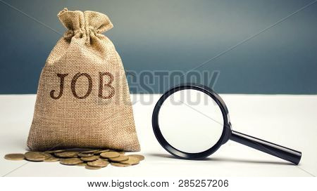 Money Bag With The Word Job And A Magnifying Glass. Work Search Concept. Available Job Vacancies. Hi