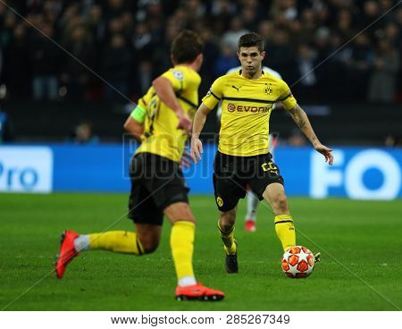 LONDON, ENGLAND - FEBRUARY 13 2019: Christian Pulisic of Dortmund during the Champions League match between Tottenham Hotspur and Borussia Dortmund at Wembley Stadium, London.