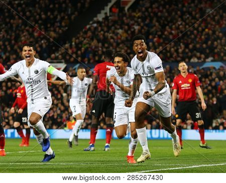 MANCHESTER, ENGLAND - FEBRUARY 12 2019: Presnel Kimpembe of PSG celebrates scoring a goal during the Champions League match between Manchester United and Paris Saint-Germain at Old Trafford Stadium.