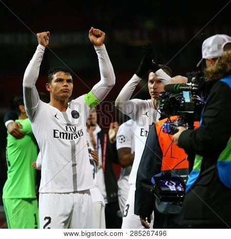 MANCHESTER, ENGLAND - FEBRUARY 12 2019: PSG players acknowledge their fans after the Champions League match between Manchester United and Paris Saint-Germain at Old Trafford Stadium.