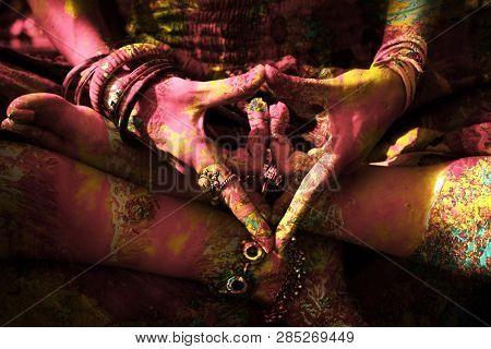 closeup of colorful woman hand in mudra gesture practice yoga outdoor shot