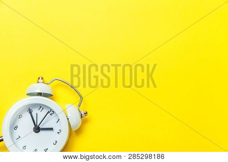 Ringing Twin Bell Vintage Classic Alarm Clock Isolated On Yellow Colourful Trendy Modern Background.