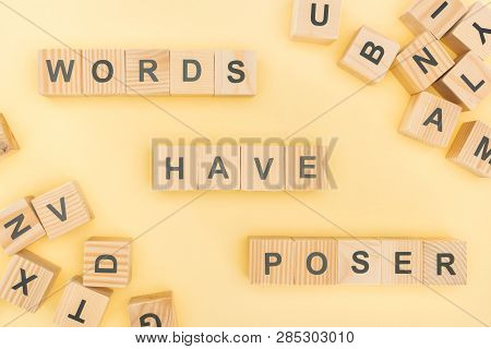 Top View Of Words Have Poser Lettering With Wooden Cubes On Yellow Background