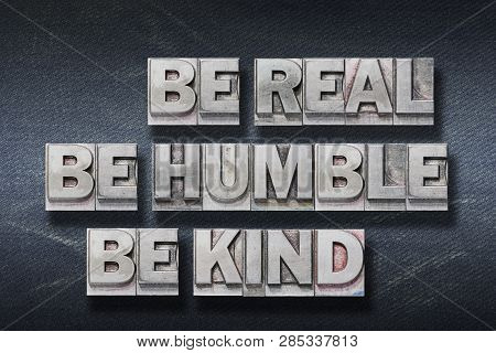 Be Real, Humble, Kind Phrase Made From Metallic Letterpress On Dark Jeans Background