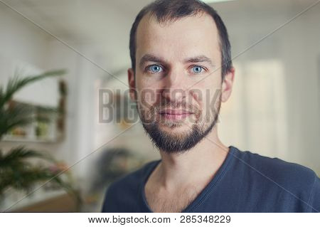 Portrait Of Handsome 35 Year Old Man At Home. Blured Background.