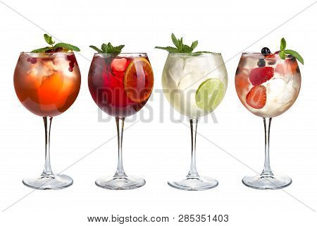 Alcohol Refreshing Cocktails With Mint, Fruits And Berries On A White Background. A Set Of Four Cock