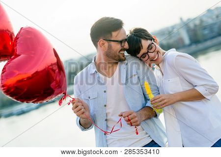 Sentimental Young And Smiling Couple In Love Bonding