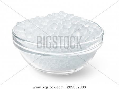 Glass bowl full of silica gel granules isolated on white