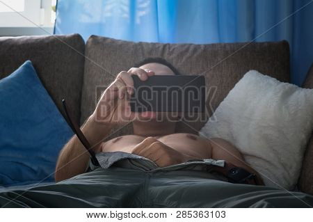 Young Man Is Watching Pornography And Masturbating.