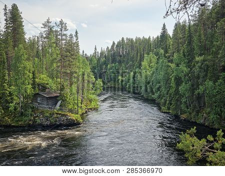 Finnish Landscape With An Old Fishermans Hut Along The Oulankajoki River At The Oulanka National Par