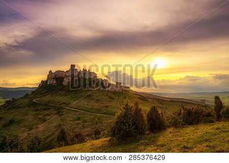 Sunset Over The Ruins Of Spis Castle In Slovakia.  Spis Castle Is A National Monument And One Of The