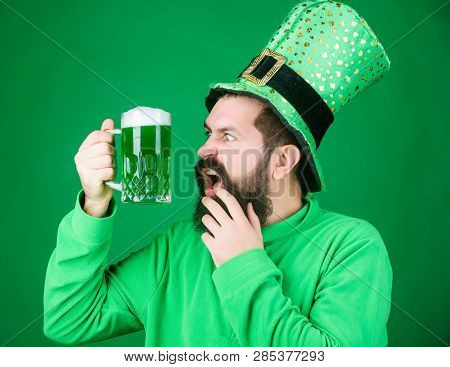 An Irishman Is Never Drunk. Bearded Man Toasting To Saint Patricks Day. Hipster In Leprechaun Hat Ho