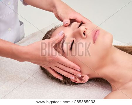 Leisure. Woman In Spa Salon. Massage And Face Care. Spa Face Massage Woman Hands Treatment.