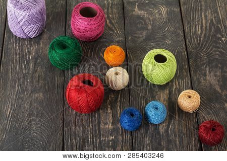 Top View. Colored Wool Skeins For Knitting Or Crochet In The Dark Boards