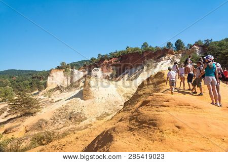 Roussilion,france-august 13,2016:tourists Visiting The Famous Ocra Color Quarries Near Roussillon In