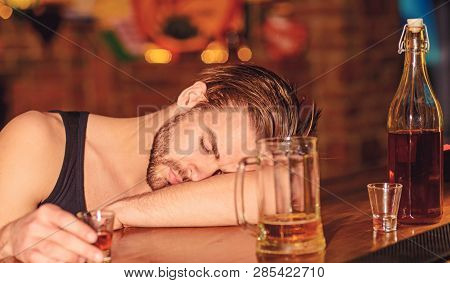 He Should Be Concerned About His Habit. Alcoholic Man Sleeping At Bar Counter. Man Sleep After Drink