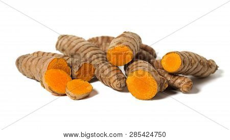 Turmeric Roots Sliced Close Up Healthy Spice Asian Food Isolated On White Background.