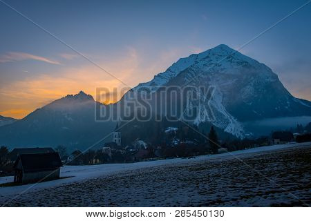 View From A Field Near Village Puergg To Sunset Over Mountain Grimming In Styria, Austria