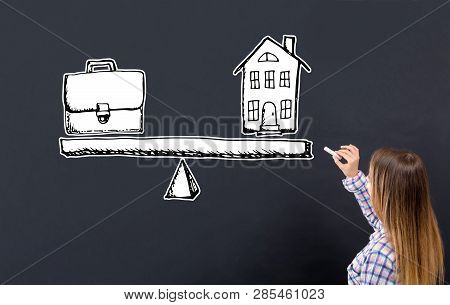 Work And Life Balance With Young Woman Writing On A Blackboard