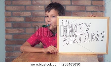 Portrait Little Boy Showing Whiteboard With Handwriting Happy Birthday. Child Has Fun With Toy. Prea