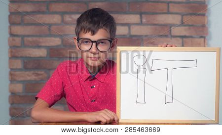 Portrait Little Boy Showing Whiteboard With Handwriting Word It. Child With Spectacles On Smart Face