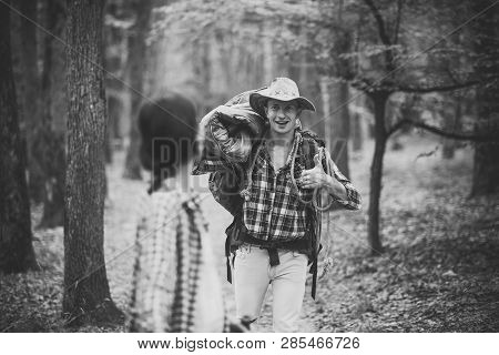 Man With Woman Hiking With Overnight Stay Or Picnic. Couple In Love Hiking In Forest With Touristic