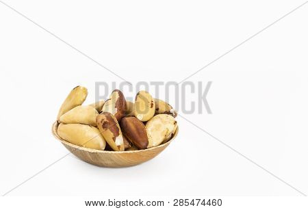 Bowl Of Brazil Nuts (bertholletia Excelsa) On A White Background