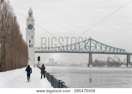 Montreal, Ca - 21 February 2019: St. Lawrence River, Clock Tower And Jacques Cartier Bridge In The O